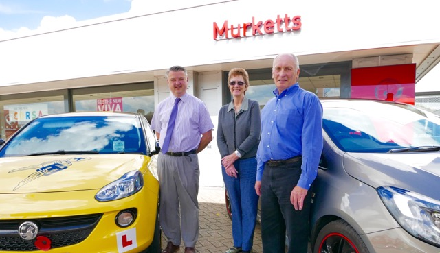 Kay and Grant with our new Vauxhall cars from Murketts